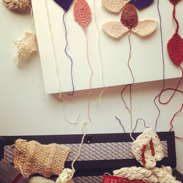 knits tumbling out of a box file